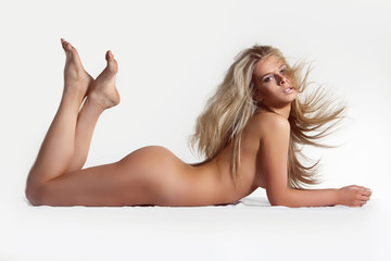 Beautiful naked woman with long smart fair hair