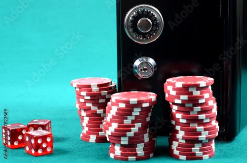 Poker gambling chips on a green playing table плакат