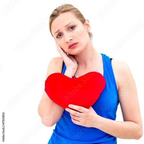 Fotografie, Obraz  sad woman holding red valentine heart