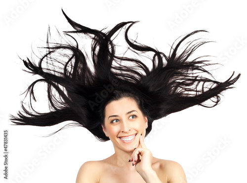 Fotografie, Obraz  Young woman with long splayed hair. isolated