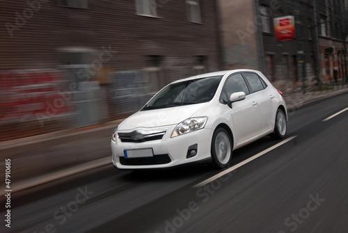 Foto Hybrid car is in motion