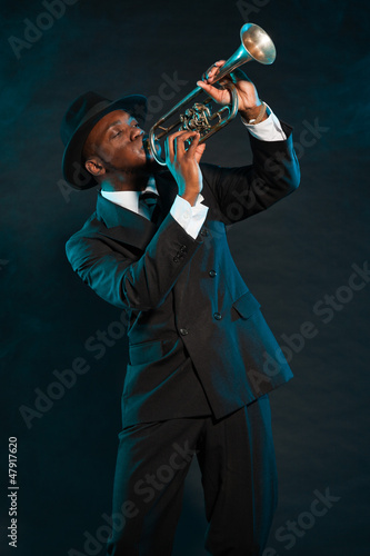 Fotografie, Tablou Black american jazz trumpet player. Vintage. Studio shot.