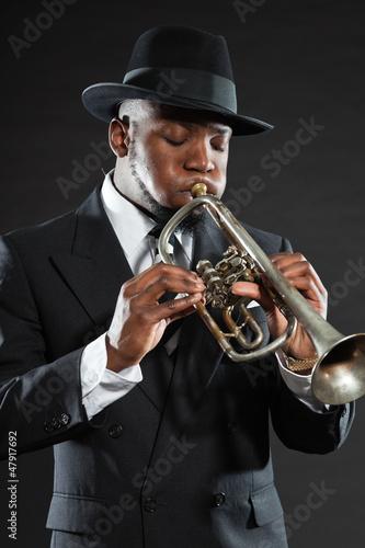 Photo Stands Music Band Black american jazz trumpet player. Vintage. Studio shot.