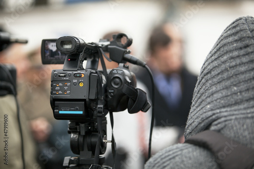 covering an event with a video camera #47919600