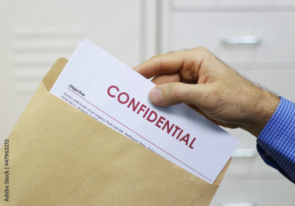 Fototapeta Man handling confidential documents