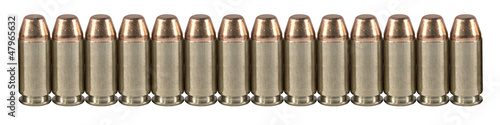 Fotografia  Bullets in a line isolated on white