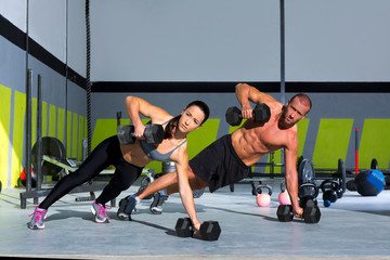 Fototapeta Gym man and woman push-up strength pushup