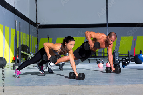 Gym man and woman push-up strength pushup #47985801