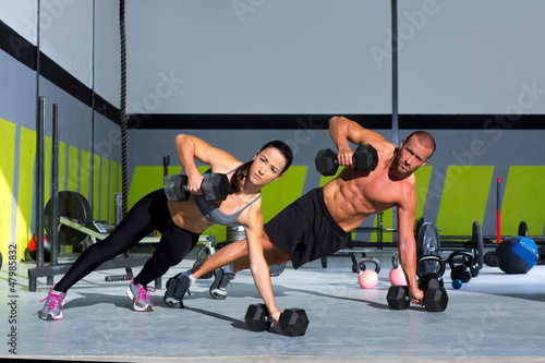Gym man and woman push-up strength pushup - 47985832