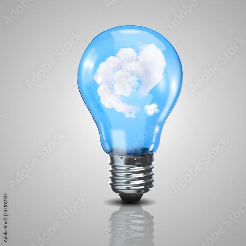 Fototapeta Electric light bulb and blue sky inside it obraz na płótnie