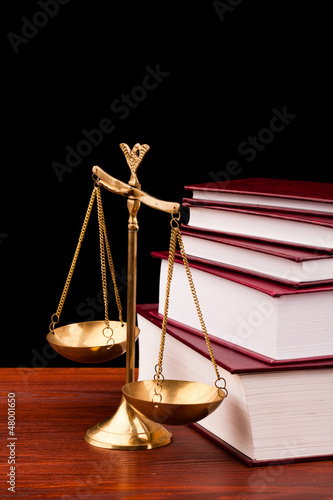 Fotografija  books of justice and scale on wooden table