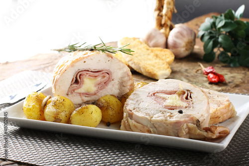 Fotografie, Obraz  Roulade of stuffed chicken with potatoes and rosemary