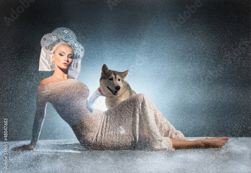 Photo  Snow maiden with dog