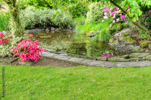 Fotografie, Obraz  Landscaped garden scene with fish pond