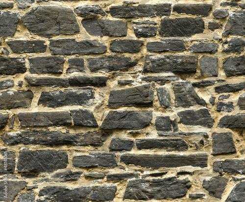 seamless black ashlar old stone wall texture