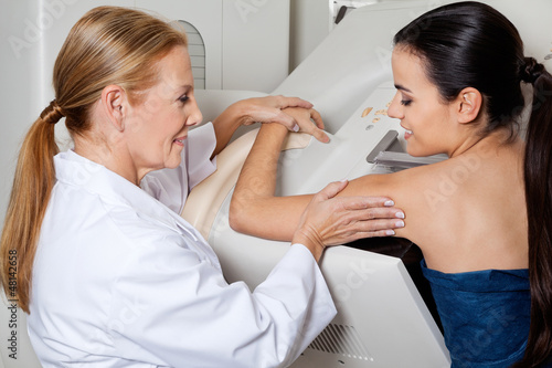 Fotografia, Obraz  Doctor Assisting Patient During Mammography