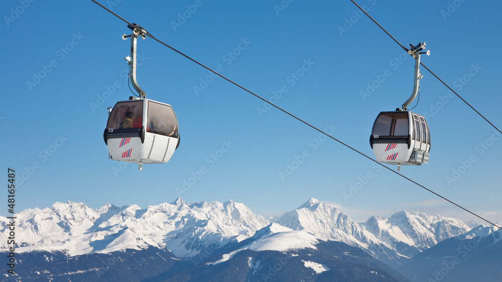 Fototapety, obrazy: Ski Lift Above the Mountain Peaks