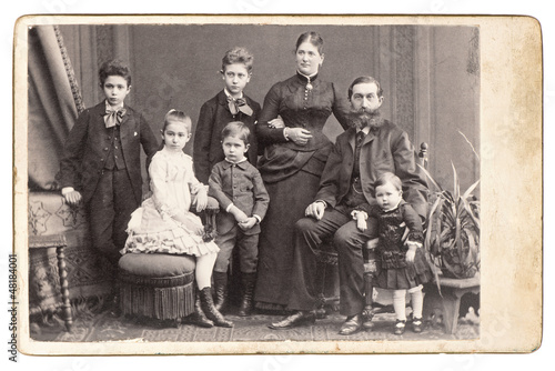 old family photo. parents with five children
