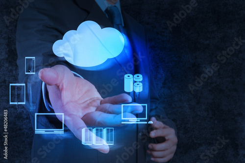 Businessman hand shows a Cloud Computing diagram