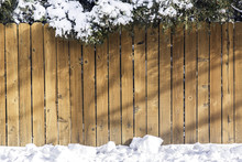 Wooden Fence With Snow On The ...