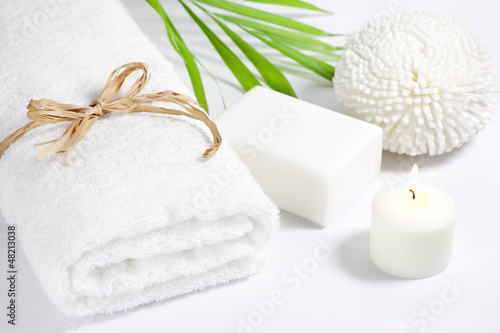 Fotografia  Towel and sponge spa bath concept on white background