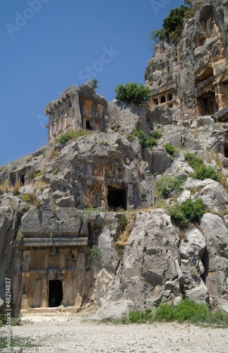 Deurstickers Rudnes Historical tombs in the mountains near Myra town , Turkey .