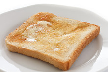 Slice Of White Buttered Toast ...