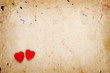 Two red hearts on old paper background