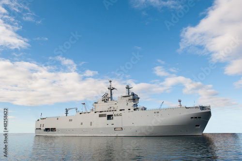 Photo  Military ship and blue sky.