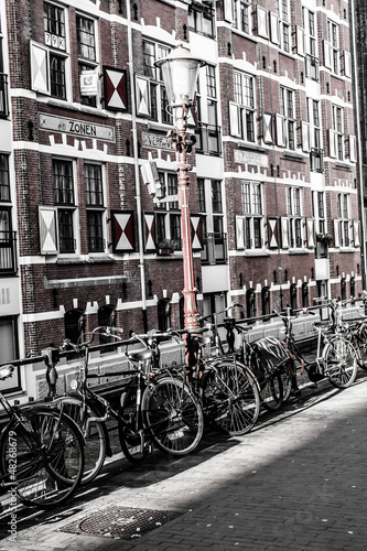 Typical Amsterdam architecture with bikes Canvas Print