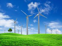 Wind Turbines Farm On Green Field Landscape