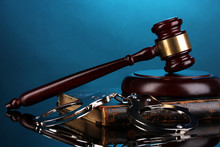 Gavel, Handcuffs And.book On Law On Blue Background