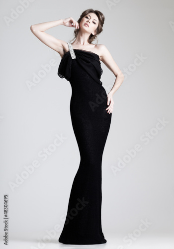 Fotografie, Obraz  beautiful woman model posing in elegant dress in the studio