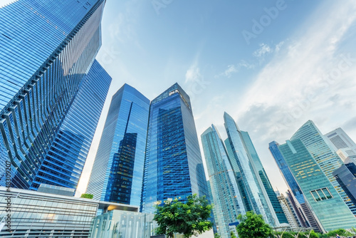 Photo Stands Singapore Skyscrapers in financial district of Singapore