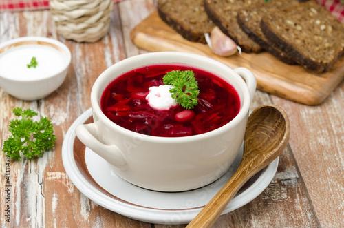 Fotografie, Obraz Ukrainian and russian national red borsch with sour cream