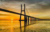 Fototapeta Bridge - Vasco da Gama bridge at sunrise, Lisbon
