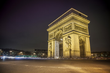 Fototapeta na wymiar Paris Arc de Triomphe de nuit - Paris Arc de Triomphe by night