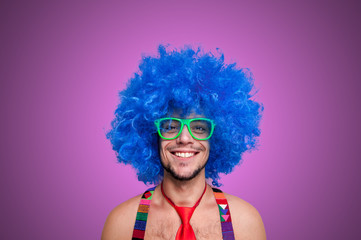 Funny guy naked with blue wig and red tie