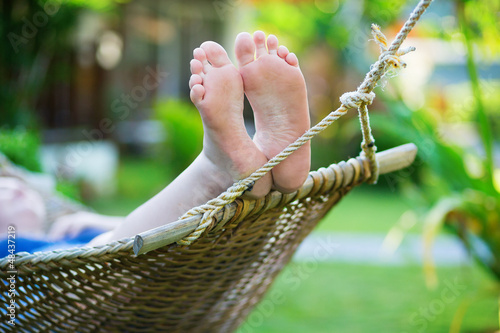 Poster  Woman relaxing in hammock on a tropical resort