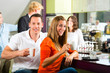 Group of people in Cafe drinking coffee