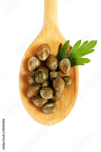 Foto op Canvas Kruiden 2 green capers in wooden spoon on white background close-up