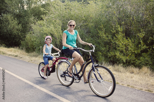 Photo Stands Cycling Family Enjoying a Bike Ride