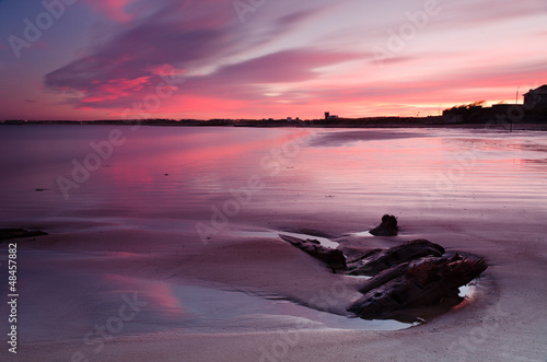 Spoed Foto op Canvas Aubergine Red sunset at Blyth beach