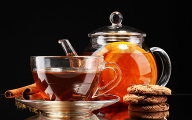 Panel Szklany Do herbaciarni Glass teapot and cup with black fruit tea and cookies isolated
