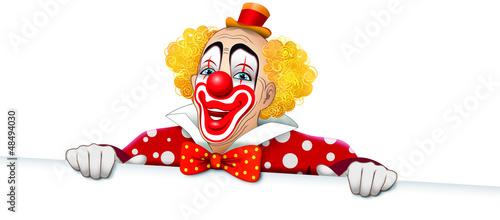 Clown sorridente con vestito a pois e cartello bianco Fotobehang