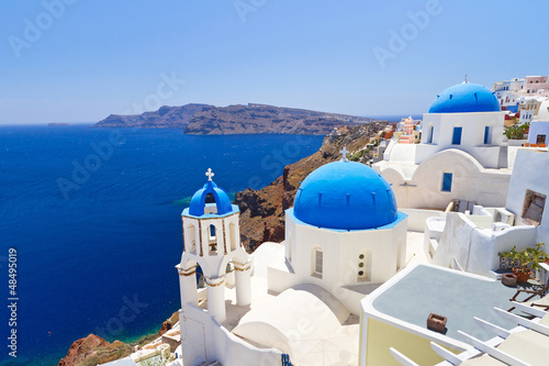 Papiers peints Santorini Blue and white church of Oia village on Santorini island. Greece