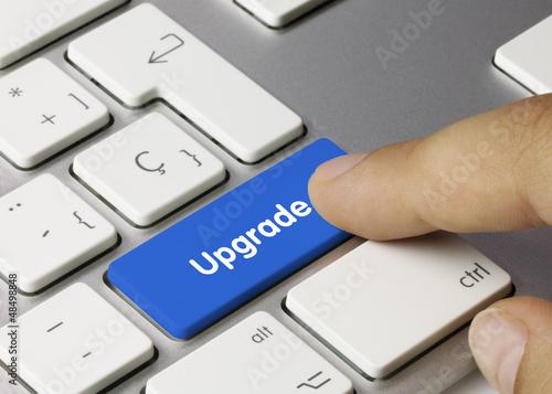 Fotografía  Upgrade keyboard key. Finger