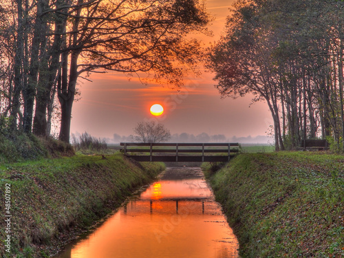 Photo Stands Nature Sunset over bridge