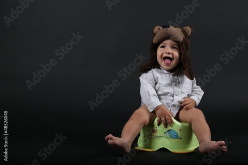 Photo  Baby boy on potty