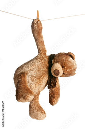 teddy bear hanging on clothesline #48618879